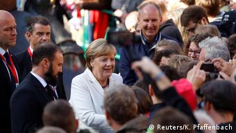 German Chancellor Angela Merkel greets people during German Unification Day celebrations in Mainz (Reuters/K. Pfaffenbach)