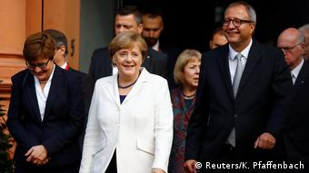 Federal Constitutional Court President Andreas Vosskuhle and wife Eva and German Chancellor Angela Merkel during German Unification Day celebrations in Mainz, Germany (Reuters/K. Pfaffenbach)