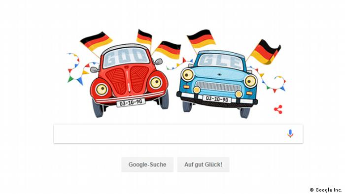 A screenshot of Google Doodle for German Unity Day showing a VW Beetle and a Trabant
