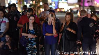 People mourn the mass shooting in the Las Vegas Strip on October 3.