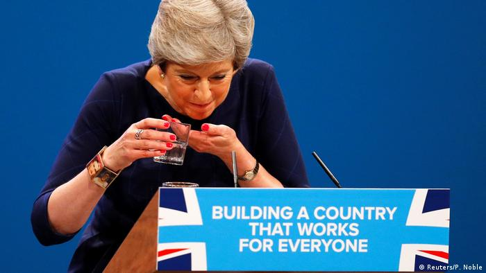 Theresa May coughing during her party conference speech in 2017 (Reuters/P. Noble)