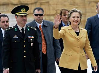 U. S. Secretary of State Hillary Rodham Clinton waves to cameras as she visits the mausoleum of modern Turkey's founder Kemal Ataturk in Ankara