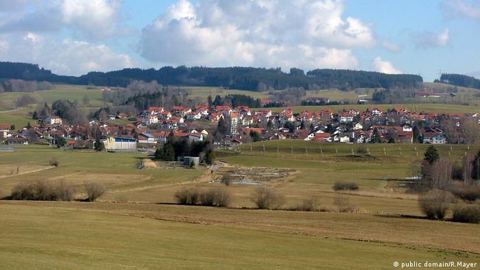 Bavarian village Wildpoldsried: surrounded by green meadows, forest in the background