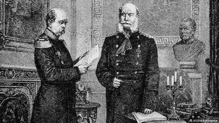 wooden engraving showing Emperor Wilhelm I checking out a piece of paper and a pensive-looking Bismarck