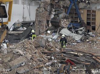 Rescue personnel at the site of the archives' collapse