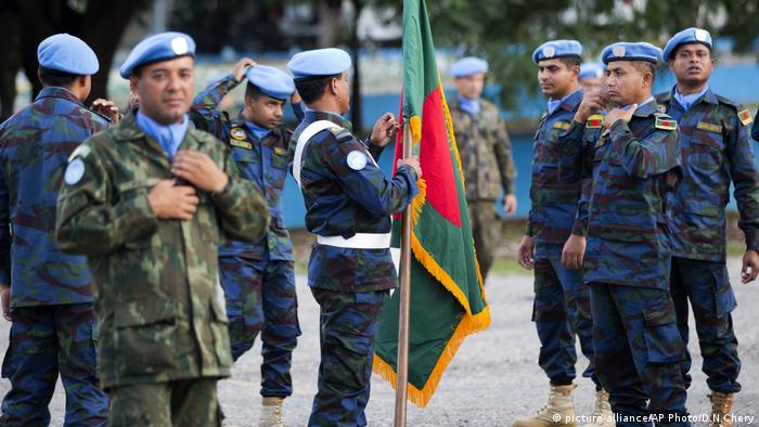 United Nations peacekeepers get ready for the end of operations ceremony