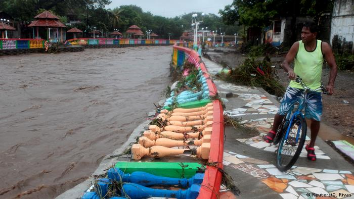 A resident look at damage caused by heavy rains of Tropical Storm Nate on Masachapa river in outskirts of Managua, Nicaragua