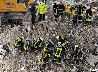 Emergency teams searching at the site where the Cologne city archive collapsed