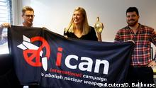 ICAN executive Beatrice Fihn (M) holding banner (Reuters/D. Balibouse)