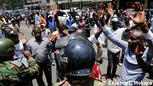 Supporters of the opposition National Super Alliance (NASA) coalition demonstrate near riot policemen in Nairobi, Kenya October 6, 2017. REUTERS/Thomas Mukoya
