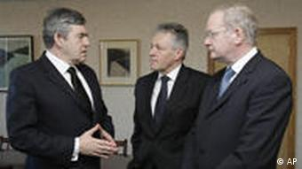British Prime Minister Gordon Brown, left, meets Northern Ireland's First Minister Peter Robinson, center, and Deputy First Minister Martin McGuinness at Castle Buildings in Stormont, Belfast, Northern Ireland Monday March 9, 2009. Brown was in Northern Ireland Monday to meet with soldiers, police and political leaders following the first deadly attack on security forces there in 12 years.