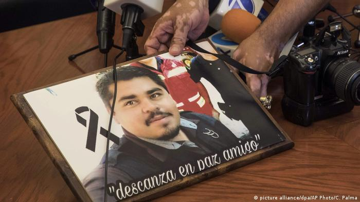 Esqueda's colleagues gathered in protest before the start of an official press conference, demanding justice for his murder