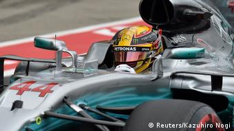 Hamilton behind the wheel during qualifier at Japanese Formula One Grand Prix.