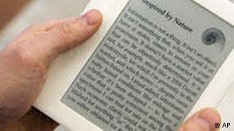 A person holding a Sony e-book reader