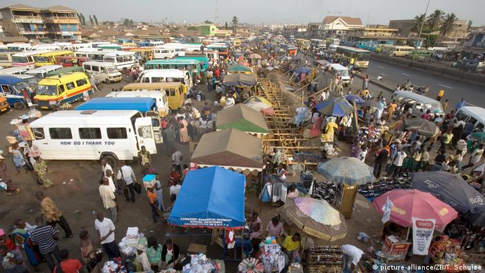 Buses, stalls and vendors seen in Kaneshi market in Accra