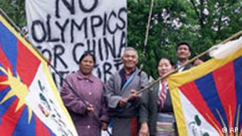 Tibetan demonstrators stand in front of the International Olympic Committee, IOC, headquarter in Lausanne, Switzerland, Tuesday May 15, 2001, calling for Beijing to be refused the right to stage the 2008 Olympic Games