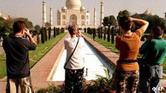 Tourists taking pictures of the Taj Mahal in India