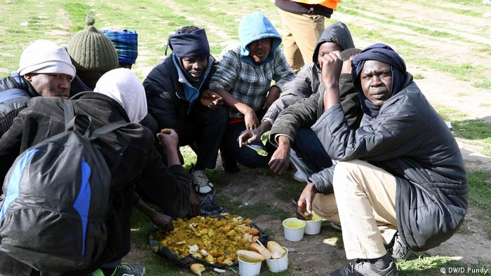 Refugees in Calais having lunch