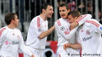 Lukas Podolski being congratulated after scoring