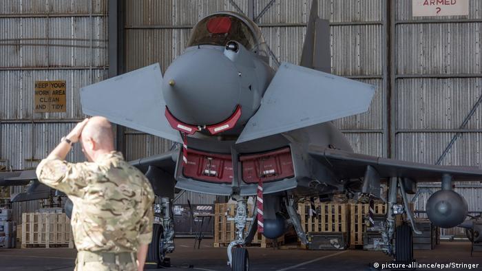 British Royal Air Force personnel work on a Typhoon FGR4 at RAF Akrotiri, a British air base in Cyprus