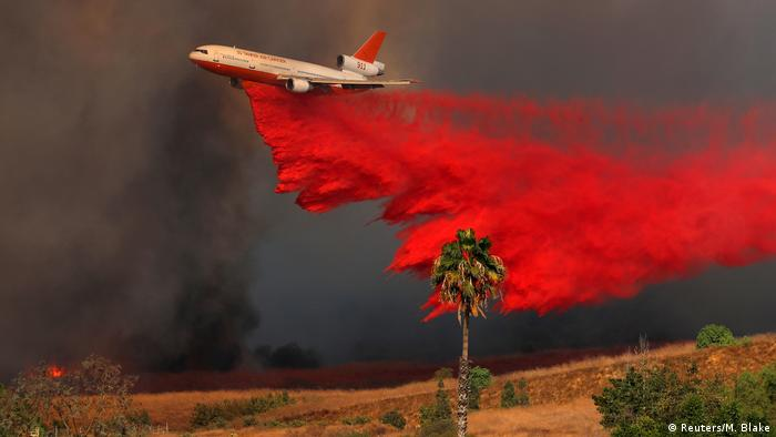 Air crews dropping fire retardant to stop the spread of the wildfires