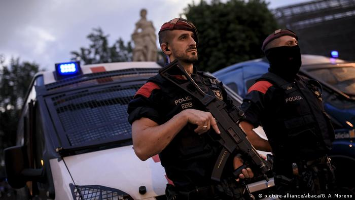 Armed Catalan police guard the Catalan parliament ahead of Puigdemont's speech
