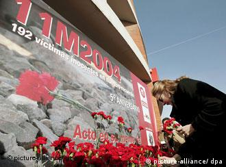 Woman with flowers at memorial site
