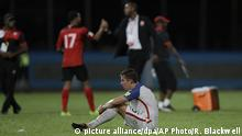 United States' Matt Besler, squats on the pitch after losing 2-1 against Trinidad and Tobago during a 2018 World Cup qualifying soccer match in Couva, Trinidad, Tuesday, Oct. 10, 2017. (AP Photo/Rebecca Blackwell) |
