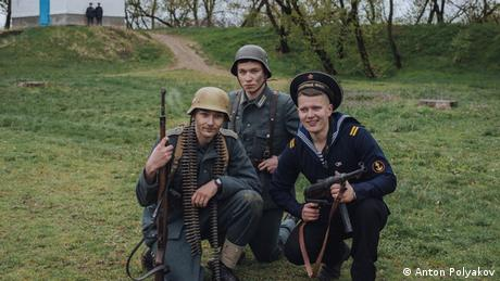 three soldiers posing with guns