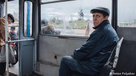 man sitting on a bus
