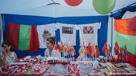 two women sitting in a tent with memorabilia