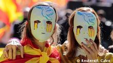 Women wear masks during a pro-union demonstration in Barcelona (Reuters/E. Calvo )