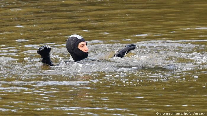 A person in a wetsuit in the Neckar River