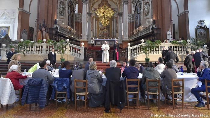 The pope speaks inside the Basilica of San Petronio before having lunch with 20 inmates