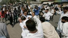 Police men in plain clothes beat protesters of an anti-government march in Karachi, Pakistan on Thursday, March 12, 2009. Pakistan arrested at least more 60 political activists, extending a nationwide crackdown Thursday aimed at thwarting an anti-government march onto the parliament.(AP Photo/Shakil Adil)