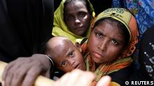 Rohingya refugees wait for humanitarian aid to be distributed at the Balu Khali refugee camp in Cox's Bazar, Bangladesh October 5, 2017. REUTERS/Mohammad Ponir Hossain
