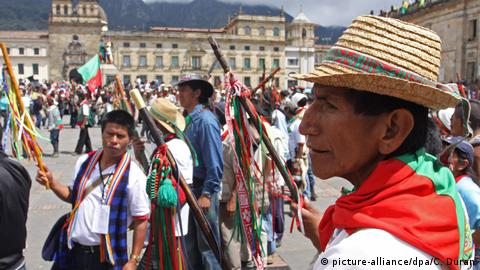 A Colombian indigenous group participate in a march in Bogota