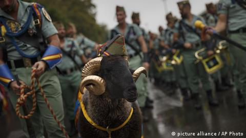 Members of La Legion, an elite unit of the Spanish Army, including a goat they use as a pet wait for the start of a military parade
