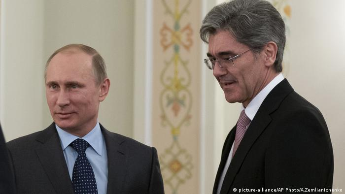 Siemens' CEO with Russian President Vladimir Putin in 2014 after the country invaded Ukraine and annexed the Crimea