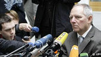 German Interior Minister Wolfgang Schaeuble, right, delivers a statement in Berlin, Germany, Thursday March 12, 2009 on the shooting