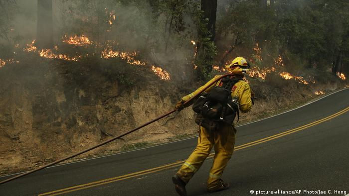 A firefighter battles a blaze in California