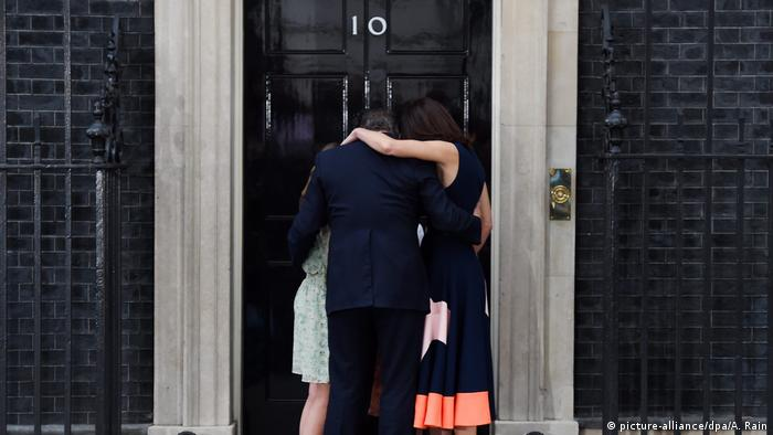 British Prime Minister David Cameron hugs his wife, Samantha, and family in front of 10 Downing Street.
