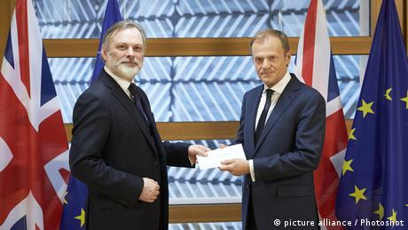 British ambassador to the EU, Tim Barrow, hands over letter to EU Council President Donald Tusk on Britain triggering Article 50 to leave the EU.