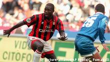 ** FILE ** Milan's forward George Weah, left, dribbles past Napoli defender Mirko Taccola during their Italian Serie A soccer match in Milan Sunday, Oct. 20, 1996. African soccer legend Weah is one of the leading candidates running in the Oct. 11 elections in Liberia, the West African country's first elections since civil war ended two-years ago. (AP Photo/Carlo Fumagalli) |