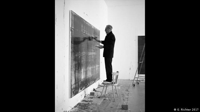 Gerhard Richter at work, black-and-white photo
