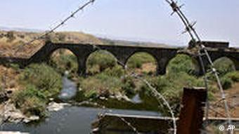 A bridge over the Jordan river between the Sea of Galilee and the Dead Sea is seen June 20, 2006. (AP Photo/Oded Balilty)