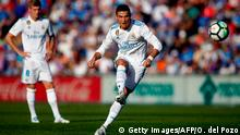 Real Madrid's Portuguese forward Cristiano Ronaldo kicks the ball during the Spanish league football match Getafe CF vs Real Madrid at the Coliseum Alfonso Perez stadium in Getafe on October 14, 2017