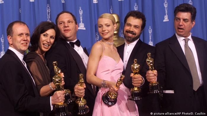 Harvey Weinstein to the left of Gwyneth Paltrow after receiving the Oscar for best picture for 'Shakespeare In Love' in 1999
