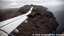 14.10.2017 +++ A picture taken from the inaugural first commercial flight between Johannesburg and Saint Helena shows the cliffs of the volcanic tropical island of Saint Helena, in the South Atlantic Ocean and part of the British Overseas Territory on October 14, 2017. / AFP PHOTO / GIANLUIGI GUERCIA (Photo credit should read GIANLUIGI GUERCIA/AFP/Getty Images)