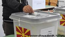 VELES, MACEDONIA - OCTOBER 15: A voter casts his ballot at a polling station during local election in Veles, Macedonia on October 15, 2017. Admir Fazlagikj / Anadolu Agency |